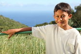 Ethnic boy in countryside sunshine — Stock Photo