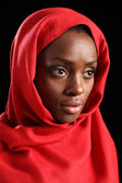 Religious african amercian woman in red headscarf — Stock Photo