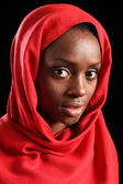 Religious african muslim woman in red headscarf — Stock Photo