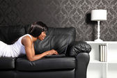 Beautiful african american woman at home with PC — Stock Photo