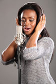 Sing song african american girl recording studio — Stock Photo
