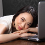 Beautiful asian girl at on laptop computer — Stock Photo