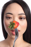 Strawberry eyes of beautiful young oriental girl — Stock Photo