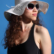Beautiful woman in hot sun swimsuit shades and hat — Stock Photo