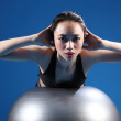Oriental Asian woman back stretch on exercise ball — Stock Photo