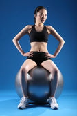 Sexy young asian woman in balance ball exercise — Stock Photo
