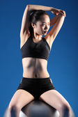 Fit beautiful asian woman warm up stretch exercise — Stock Photo