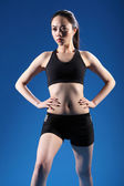 Beautiful Chinese girl warm up fitness exercise — Stock Photo
