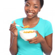 Beautiful african american girl morning cereal - Stock Photo