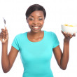 Beautiful happy black woman with breakfast cereal - Stock Photo