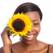 Beautiful african american girl and sunflower - Stock Photo