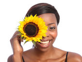 Beautiful african american girl and sunflower — Stock Photo