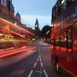 Big Ben and buses at dawn in London city England - Stock Photo