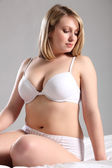 Beautiful Voluptuous woman in white lingerie — Stock Photo