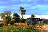 Farmstead at sunset. — Stock Photo