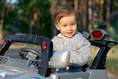Baby at the toy car — Stock Photo