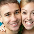Smiling tenage couple at the swimming pool — Stock Photo