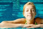 Sunbathing girl at the swimming pool — Stock Photo