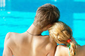 Couple a the swimming pool — Stock Photo