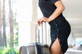 Seductive women with luggage outdoors — Stock Photo