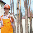 Young worker outdoors pointing at camera — Stock Photo #6602306