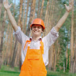Happy worker with hands up outdoors — Stock Photo