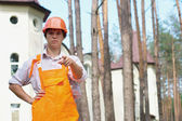 Young worker outdoors pointing at camera — Stock Photo