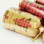 Festive christmas crackers over white background — Stock Photo