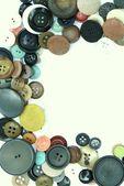Dikey dikiş düğmeleri çerçevesinin üzerine beyaz — Stok fotoğraf
