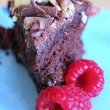 Foto de Stock  : Triple choc homemade birthday cake with raspberries
