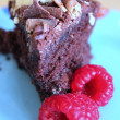 Triple choc homemade birthday cake with raspberries — Stock Photo
