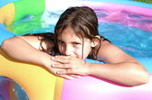Beautiful child enjoying summer in pool — Stock Photo