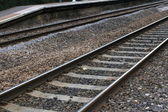 Abstract close up railway line running through station — Stock Photo