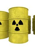 Yellow nuclear waste barrel — Stockfoto