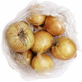 Onion in cellophane on a white background — Stock Photo