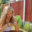 Stock Photo: Girl texting on mobile phone