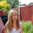 Beautiful teenage girl in garden — Stockfoto
