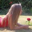 Teenage girl with red flower — Stock Photo #6653471