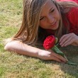 Teenage girl playing with flower — Stock Photo #6653506
