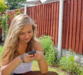Girl texting on mobile phone — Stock Photo