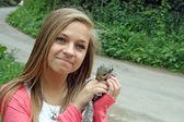 Teenage girl with a squirrel — Stock Photo