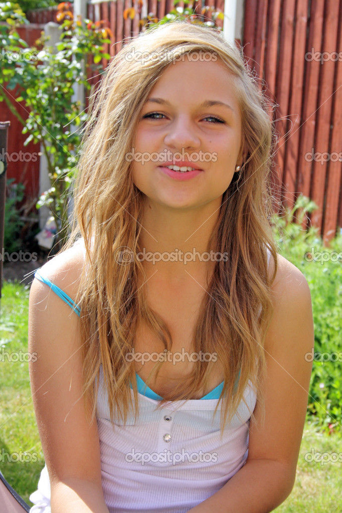 Beautiful Teenage Girl In Garden Stock Photo