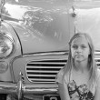 Girl sat near a classic car — Stock Photo #6736550