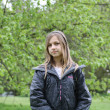 Young girl stood in a park — Stock Photo