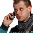 Young man talking on the phone - Stockfoto