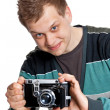 A young man with an antique camera — Stock Photo #6346569
