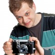 A young man with an antique camera — Stock Photo
