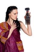 Brunette combing hair — Stock Photo