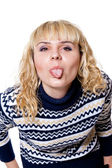 Blonde showing tongue — Stock Photo
