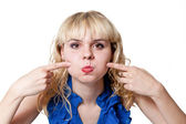 Funny blonde puffed out his cheeks — Stock Photo